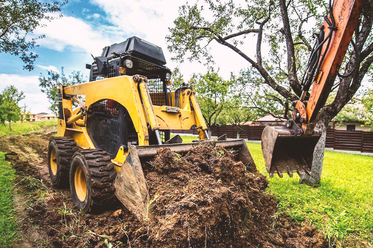 Skid-steer at work on landscaping job in Penticton, BC.