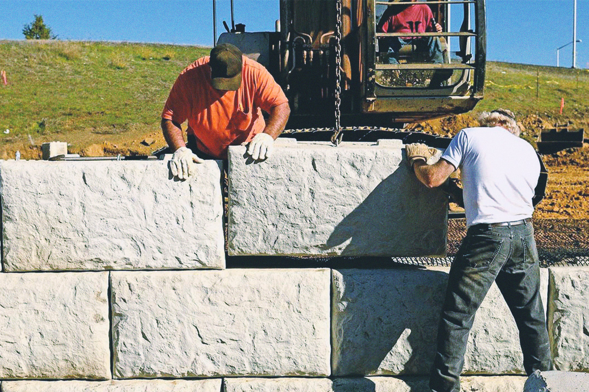 Kettle Valley Excavating staff working building a retaining in the Okanagan Valley.