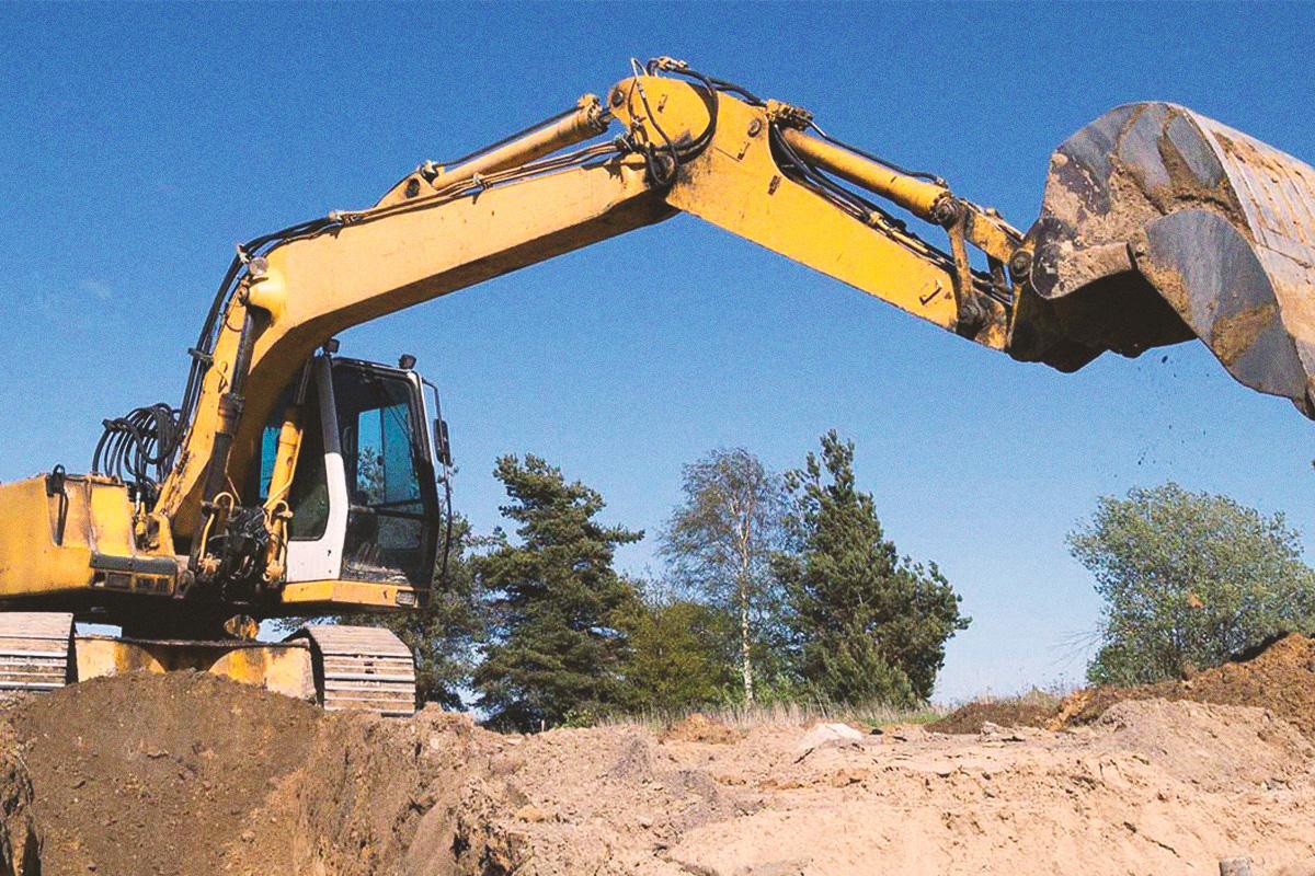 Excavator working on commercial job site in West Kelowna, BC.