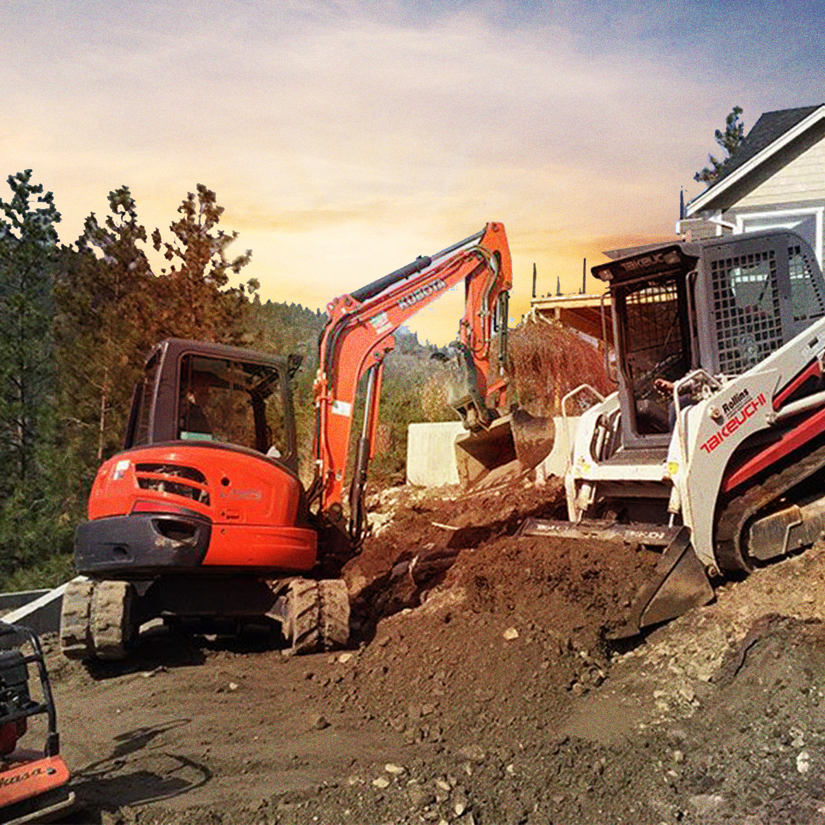 Skid-steer and backhoe working on a property Kelowna, BC.