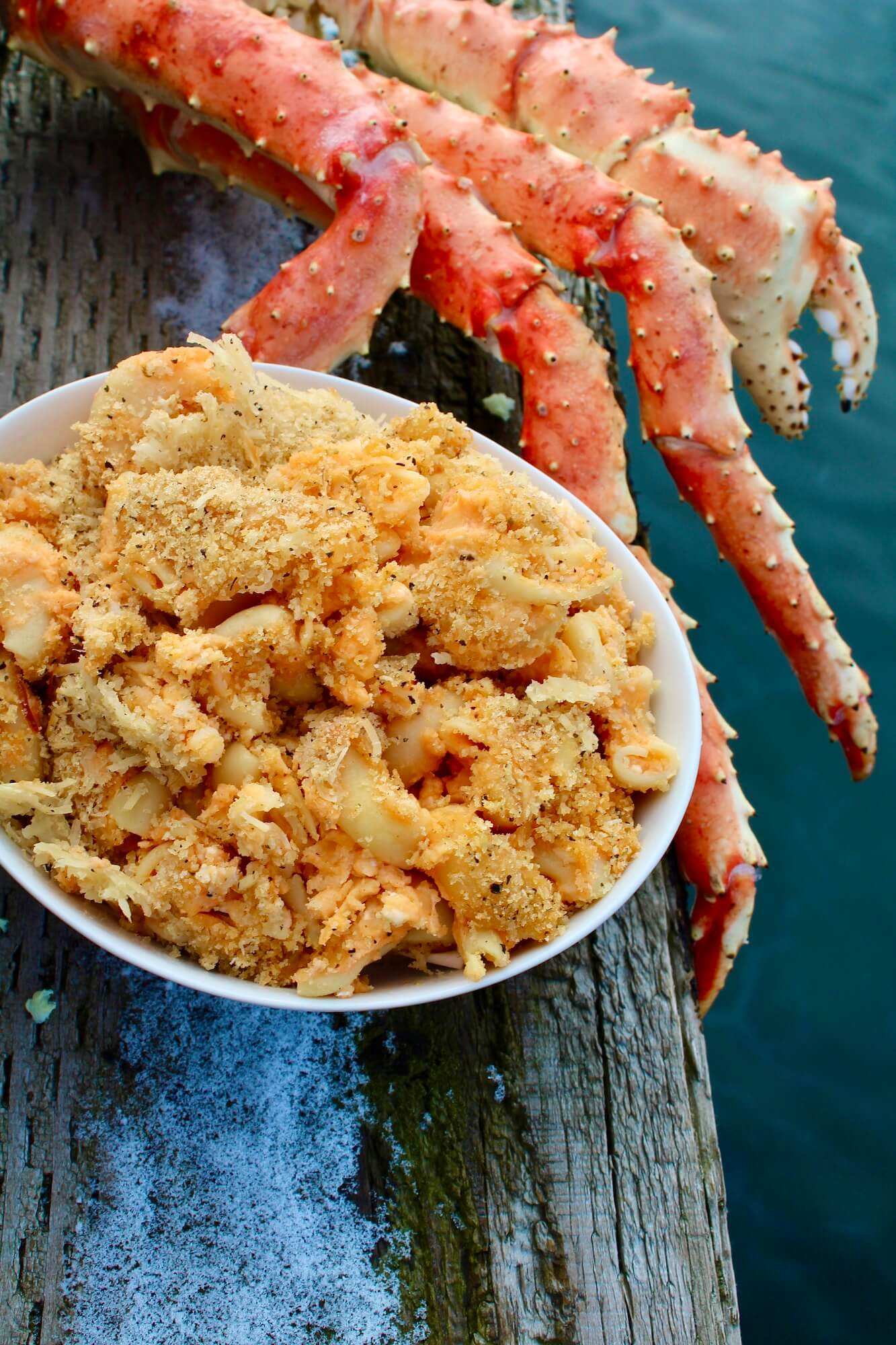 King Crab Claw next to a bowl of King Crab Mac & Cheese