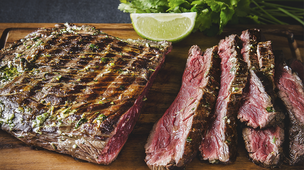 Flank steak marinated in lime and coriander
