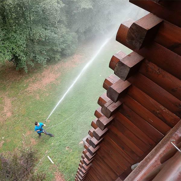 Peak Log Home Care pressure washing log cabin