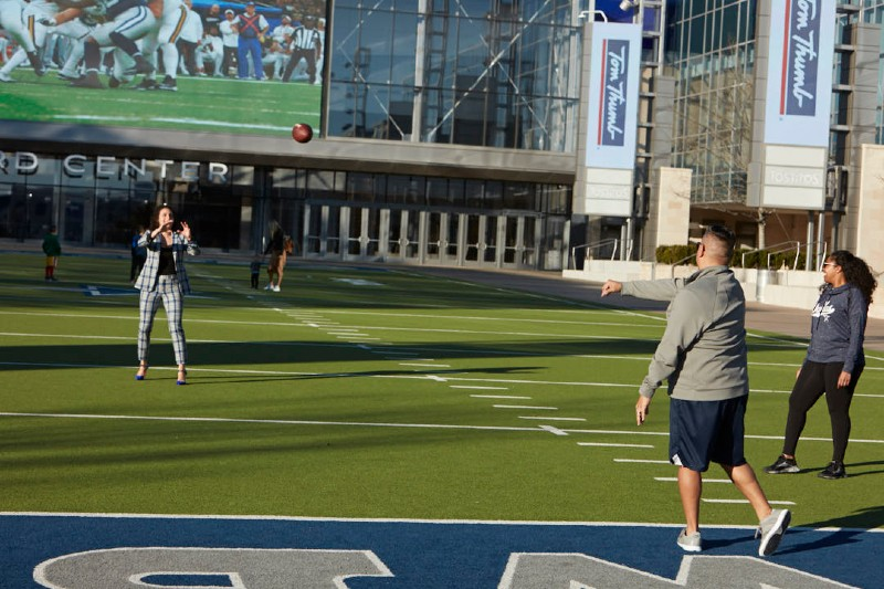 Dr.Shaggy on the Cowboy field catching a football