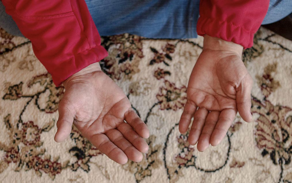 Hands open for prayer