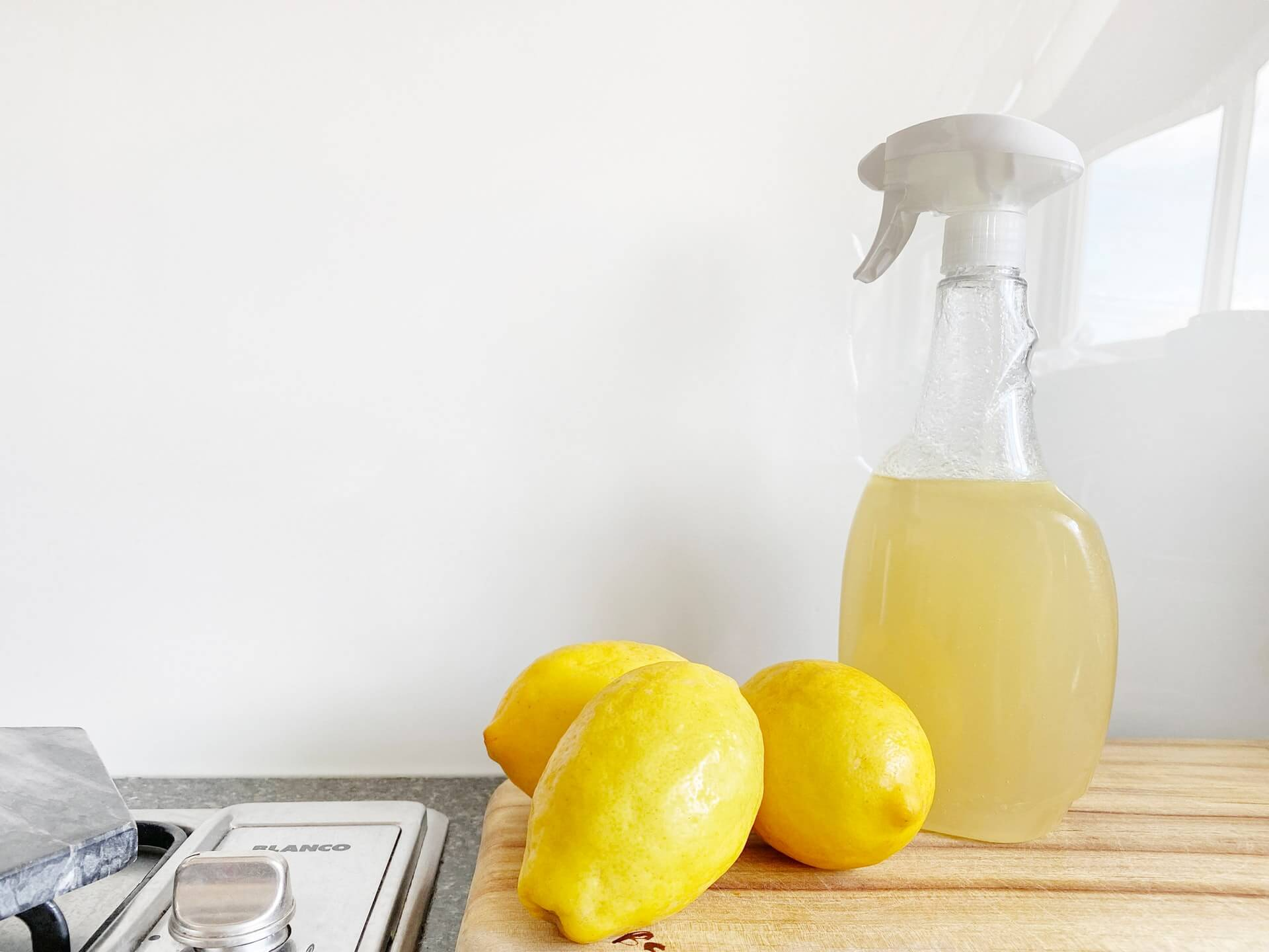 a bottle full of lemon and water in a spray