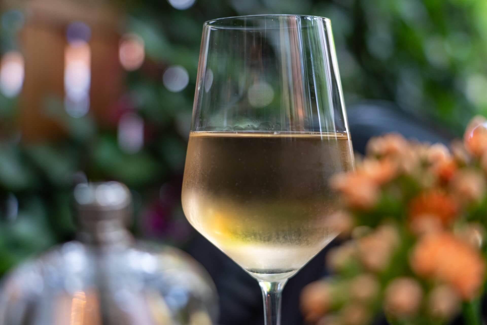 white wine in a glass to remove carpet stain