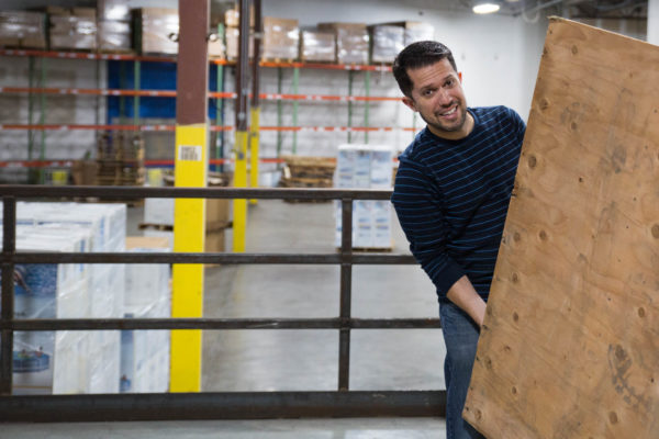 Gustavo Albino works to unload pallets of product into the Spreetail fulfillment center in Lincoln, NE. All new employees complete fulfillment training within their first months at Spreetail.