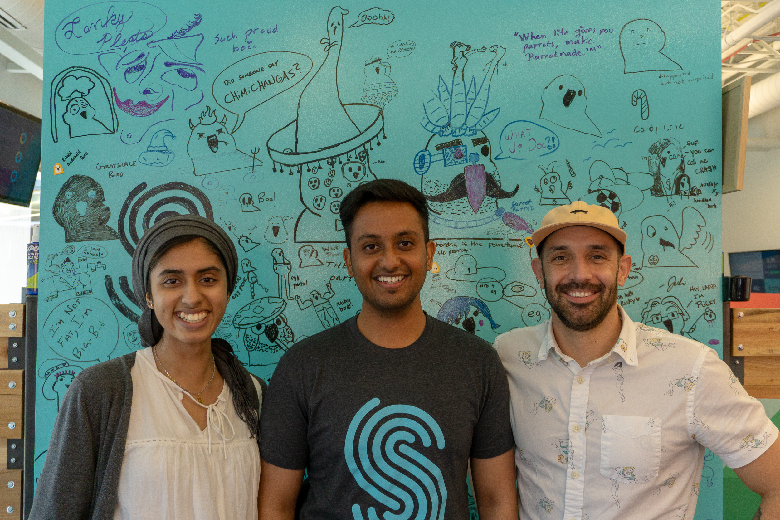 """UX Designer Bryon Stuefer poses for a photo with 2018 UX Design Interns Komel Khan and Vijit Bhati. In addition to bonding over the World Cup, these three put their varied skillsets to work on the Toolkit team. """"We traded knowledge on design and dev constantly,"""" said Bryon."""