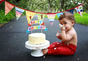 little boy eating cake