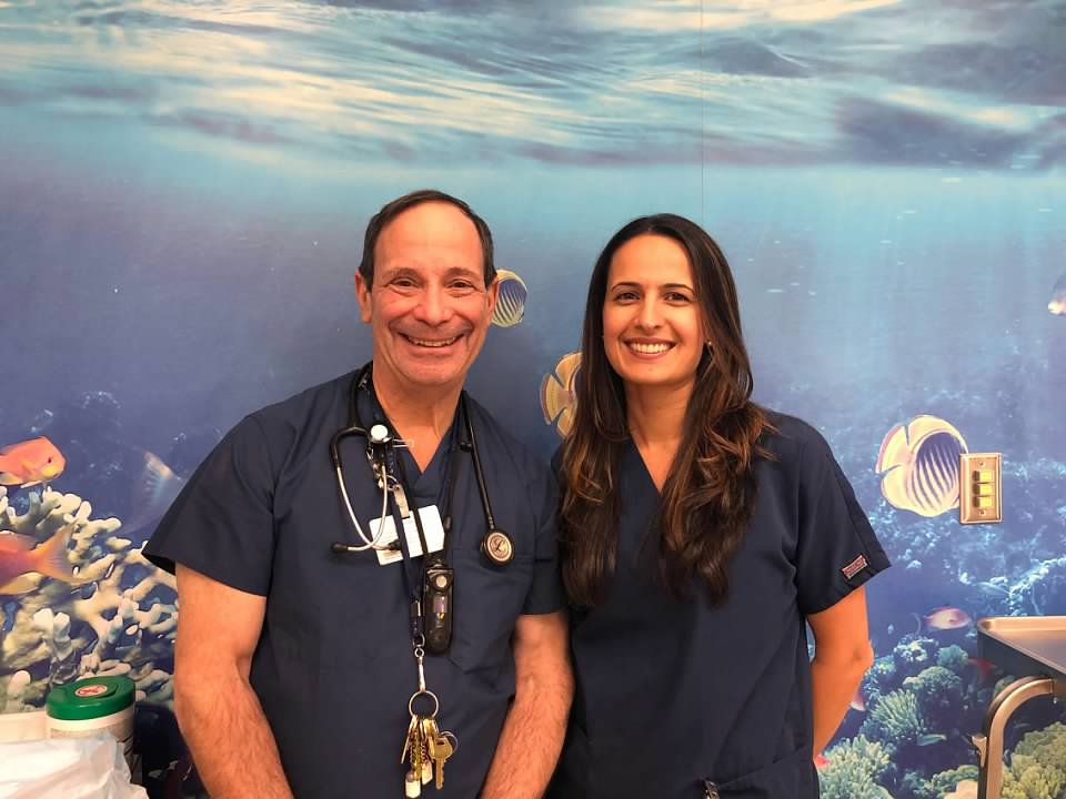 Dr. Ball smiling with another dentist