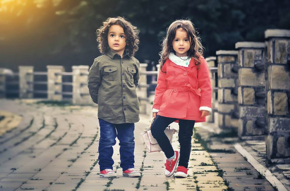 little boy and girl standing