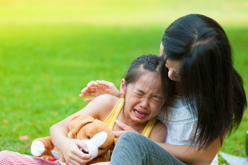 young girl crying to her mom