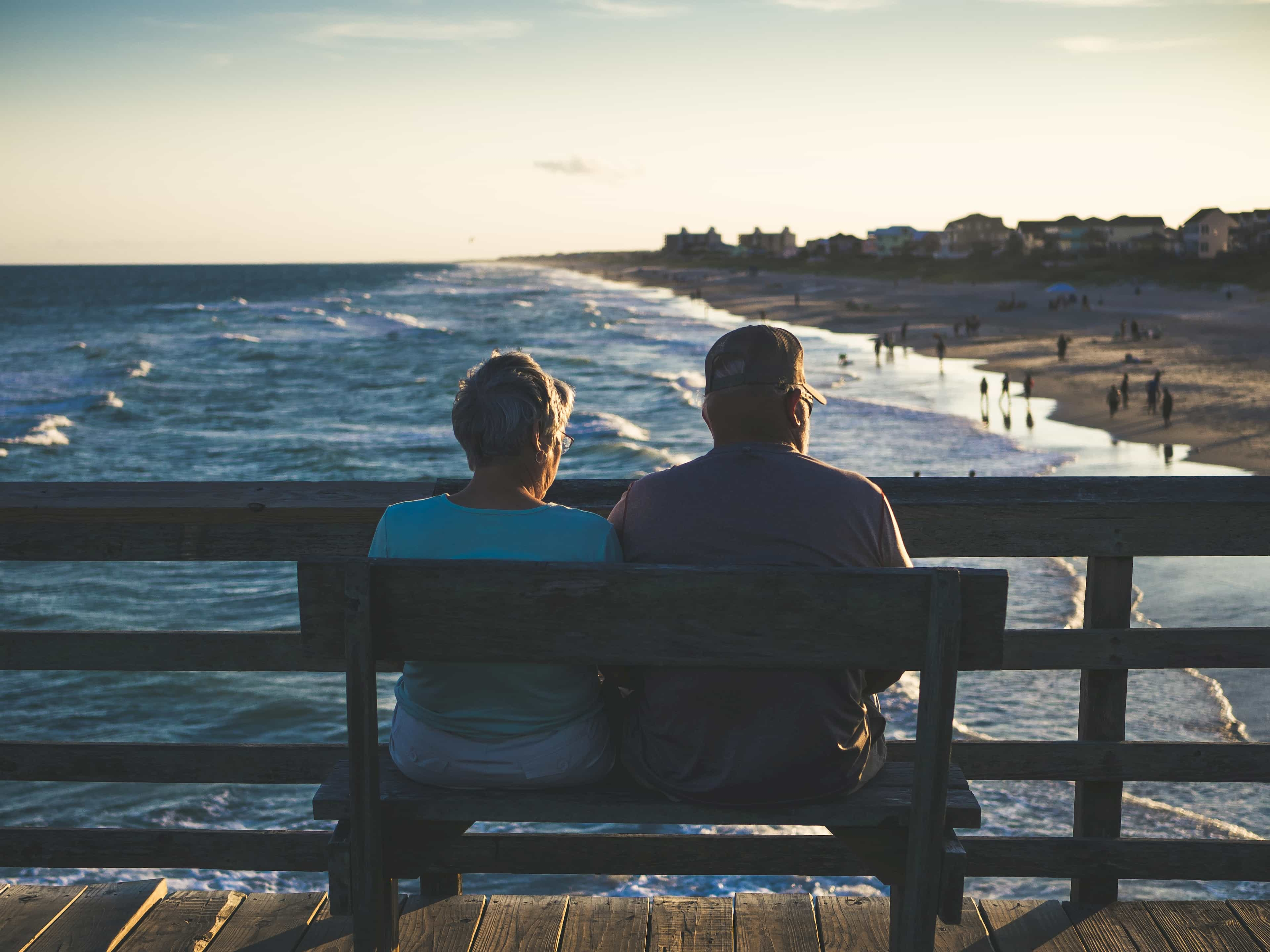 Elderly man and woman watching beach