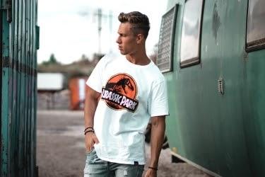 Young Man wearing a Jurassic Park T-shirt