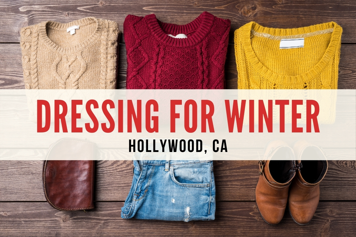 Winter clothes laid out with a pouch, jeans and a pair of boots - Dressing for Winter Hollywood, CA