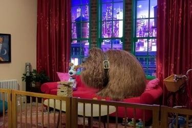 Dogs animatronics sitting in a sofa