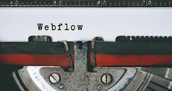 oude typemachine met lint en het woord webflow