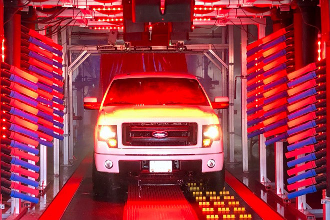 truck in car wash with red lights