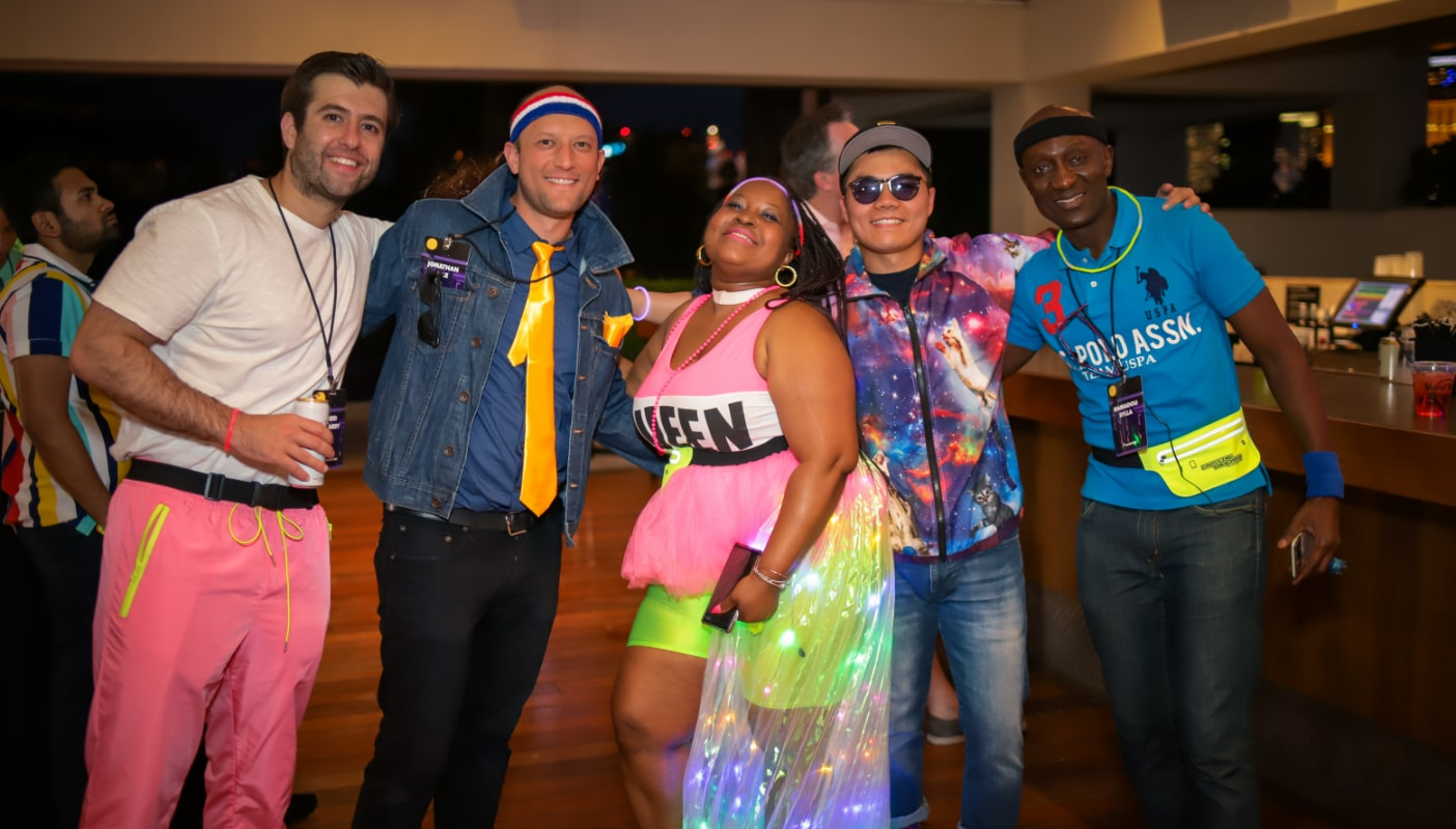 4 Staff Members in 80s attire in Vegas