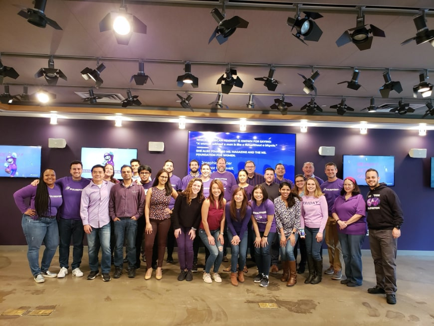Company Photo of Staff in Purple