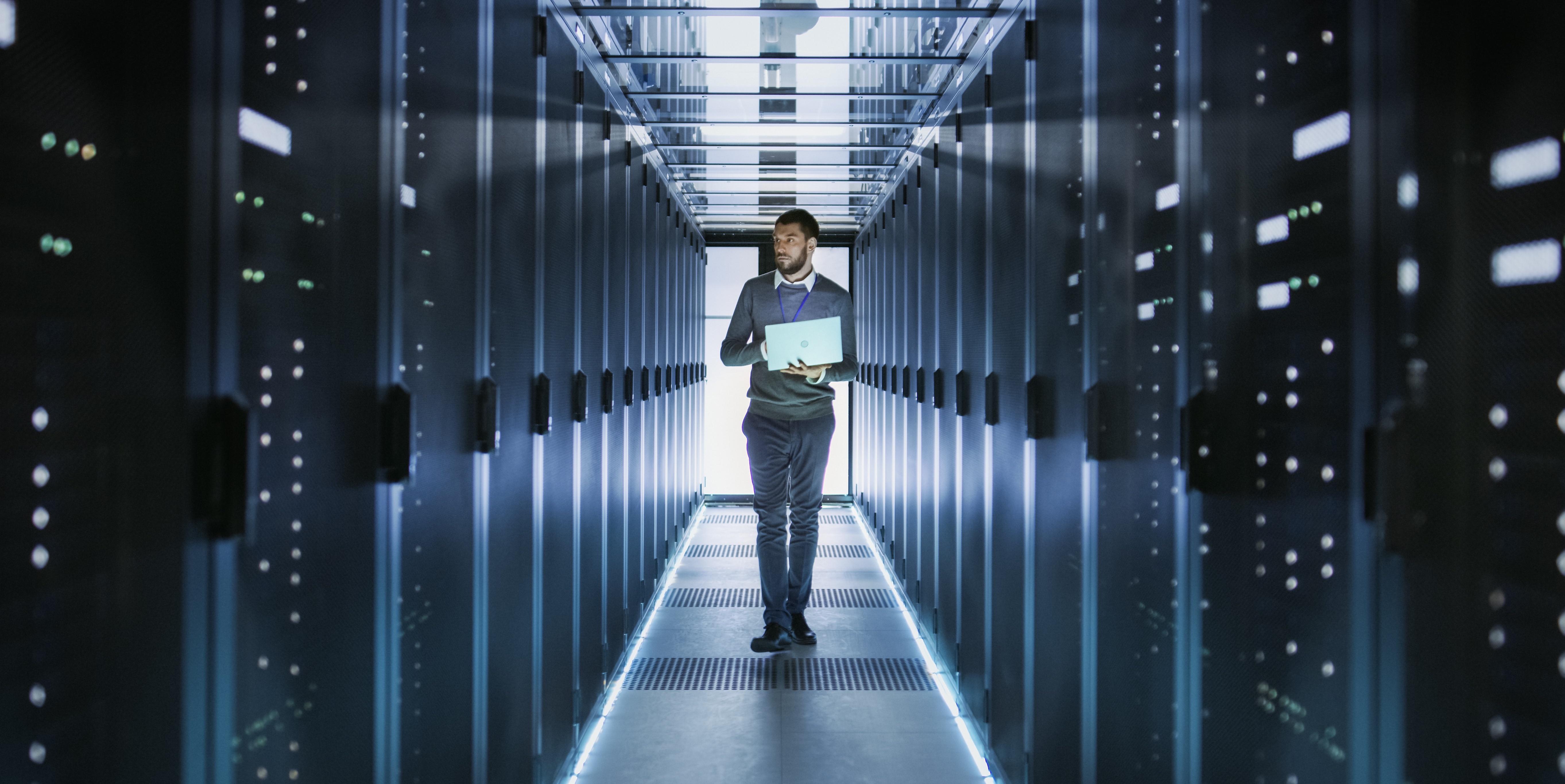 man-walks-through-data-center