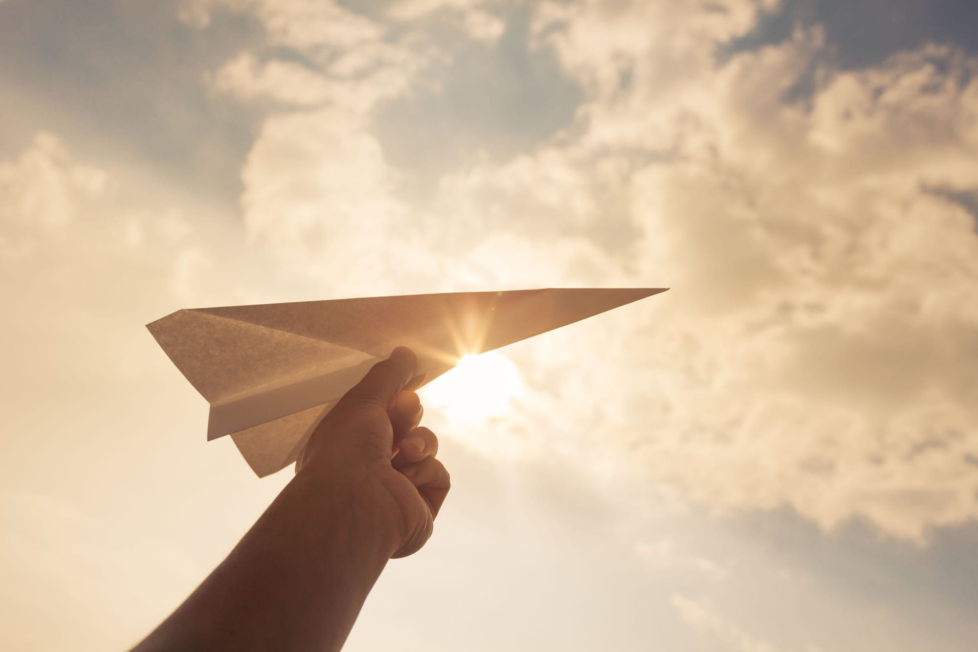paper-airplane-held-in-sky