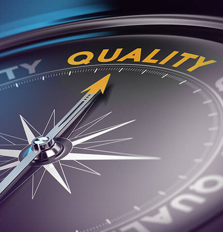 A compass pointing to the word Quality.