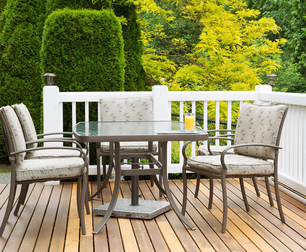 A wood deck with white railing.