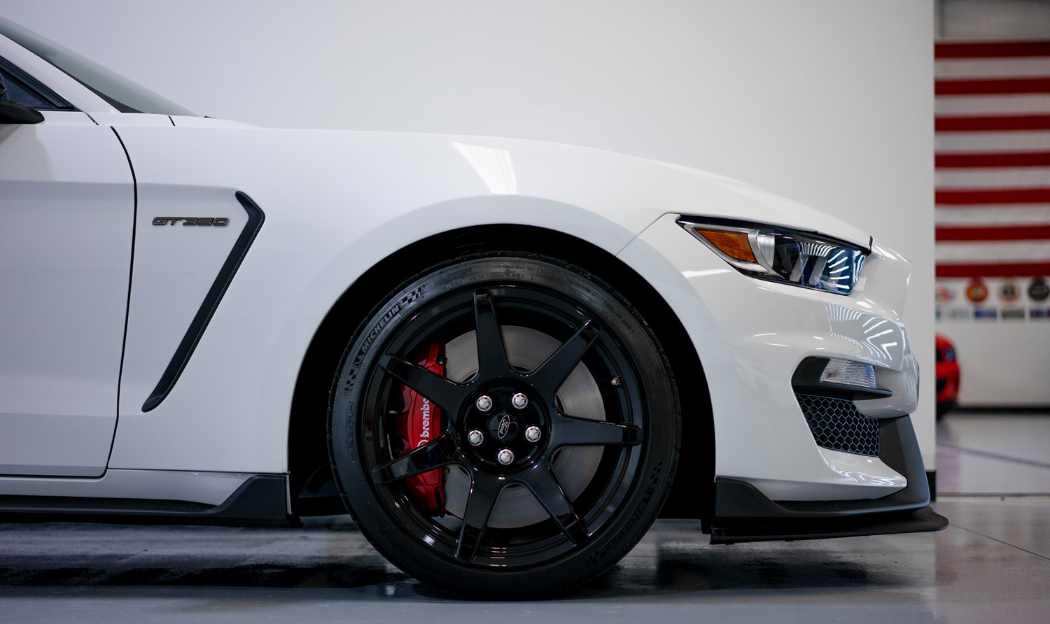 Side of white Mustang