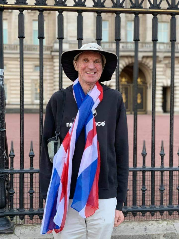 IDEA Services resident Bob Kemp wears Union Jack while visiting Buckingham Palace