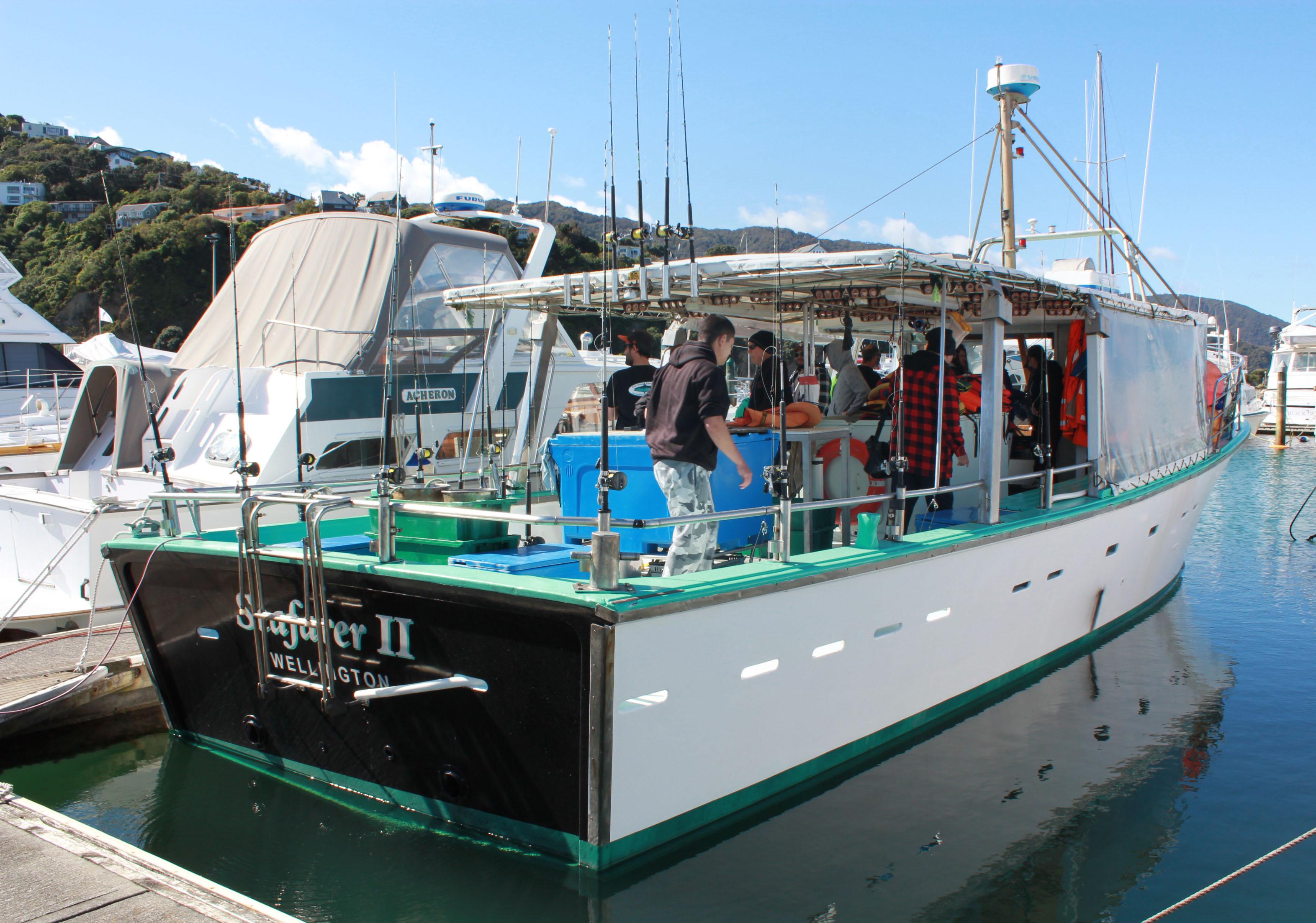 A dozen people, plus their IDEA Services support staff, enjoy day's fishing courtesy of the IHC Mana-Kapiti Association.