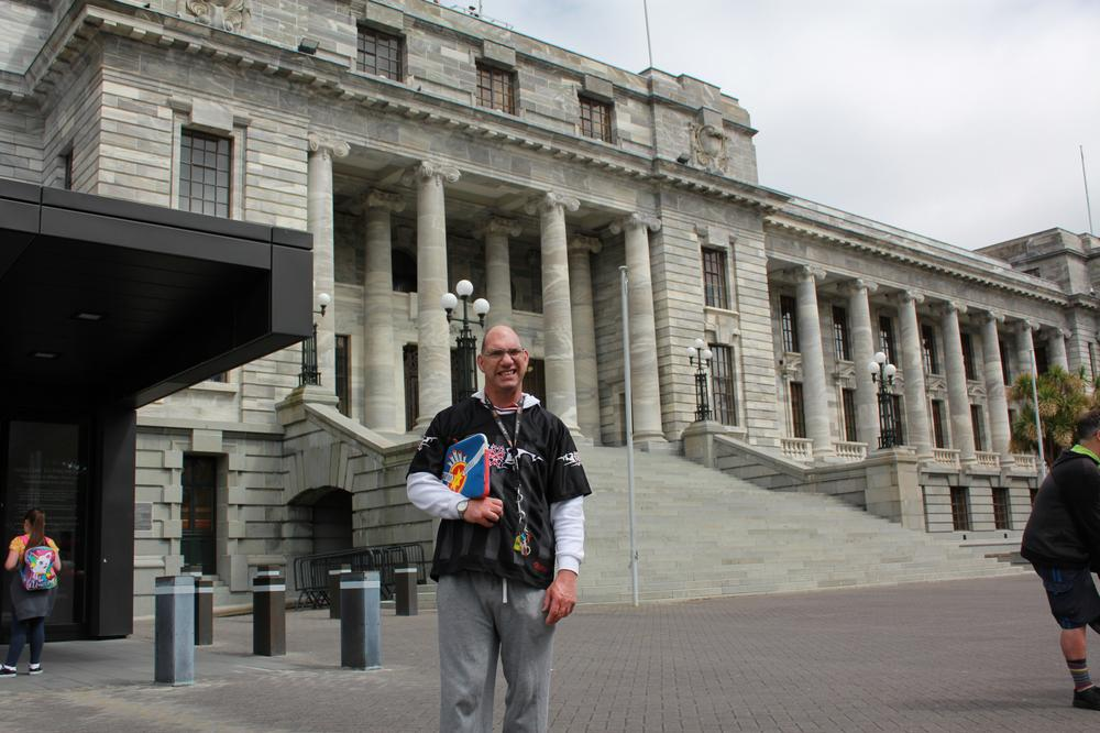 Tony Hofsteede stands outside New Zealand Parliament waiting for tour to start