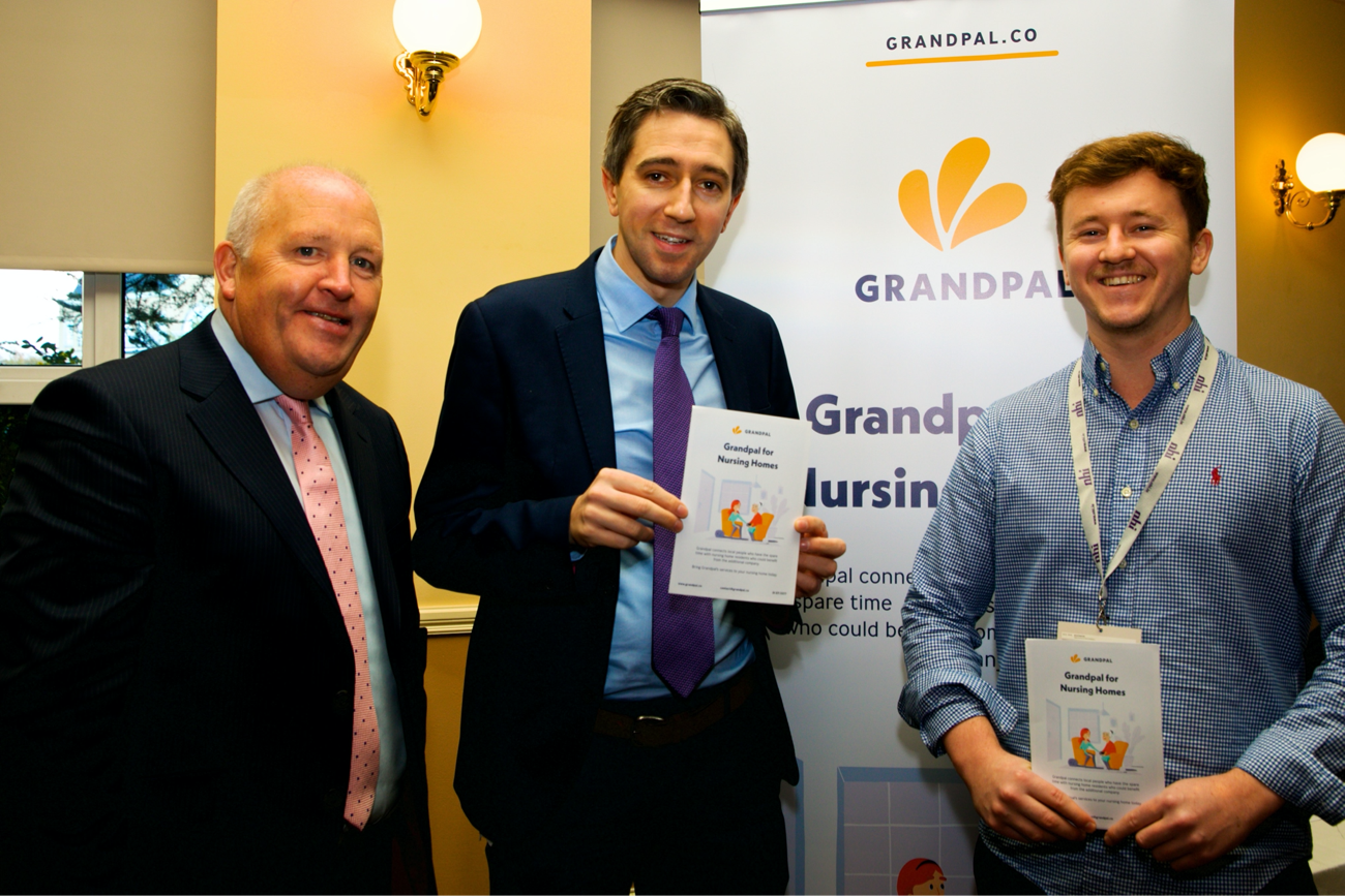 Tadhg Daly, Simon Harris and Brian Daly with Grandpal at the Nursing Homes Ireland conference