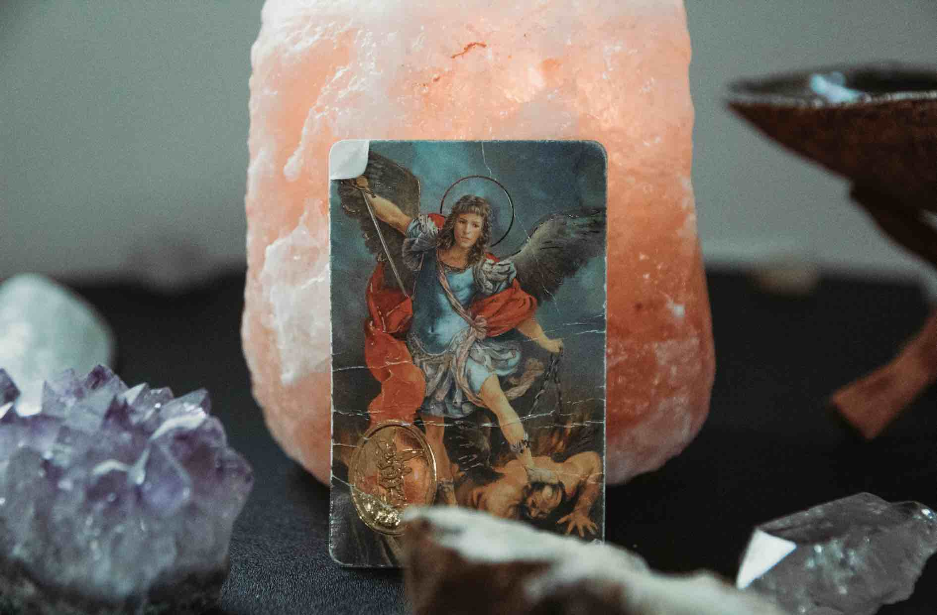 Archangel card resting against crystals