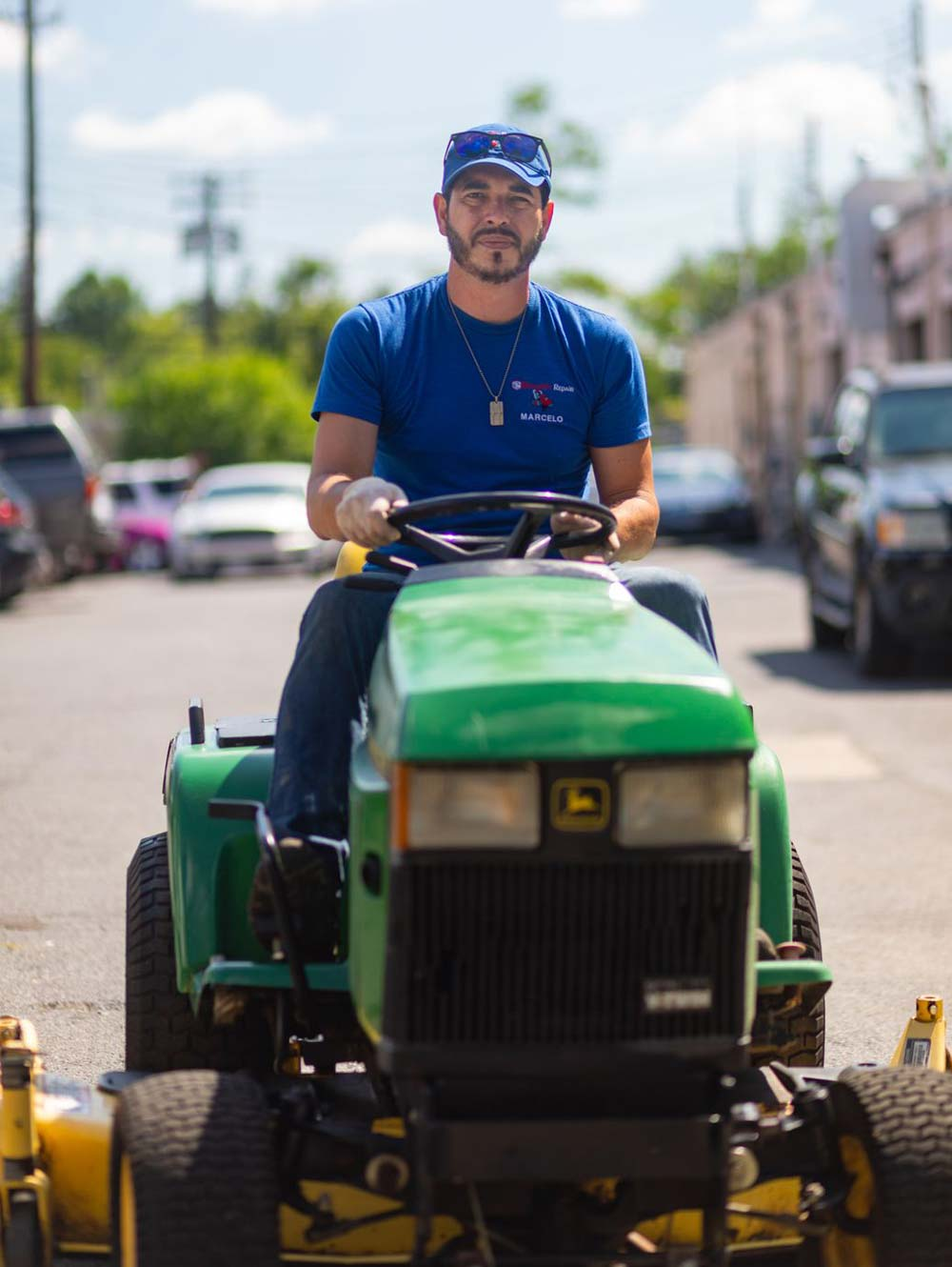 Blunard's Repair & Equipment team member riding lawn mower