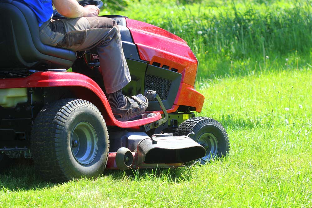 Riding lawn mower in backyard