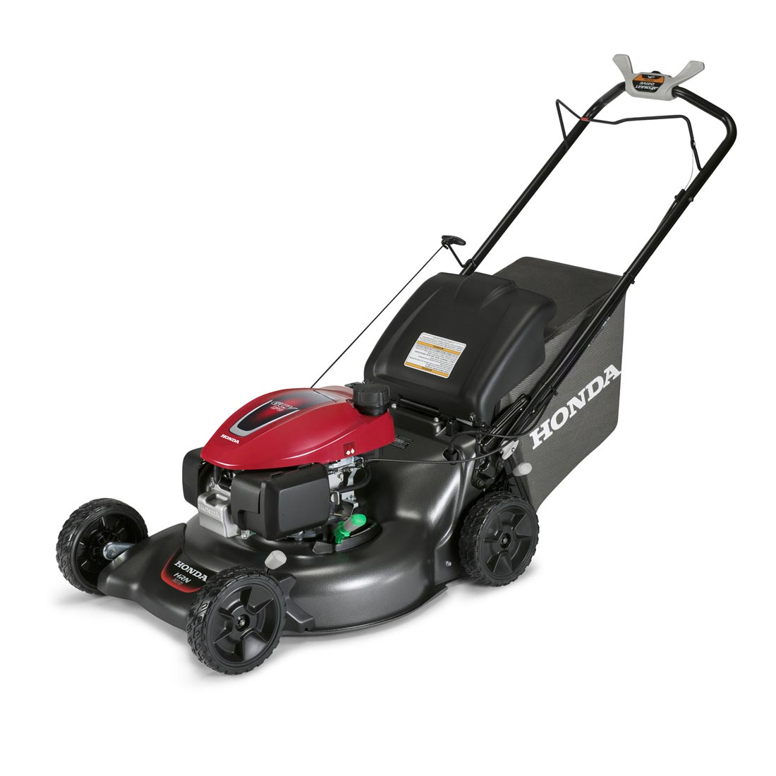 Lawn mower being used in the garden