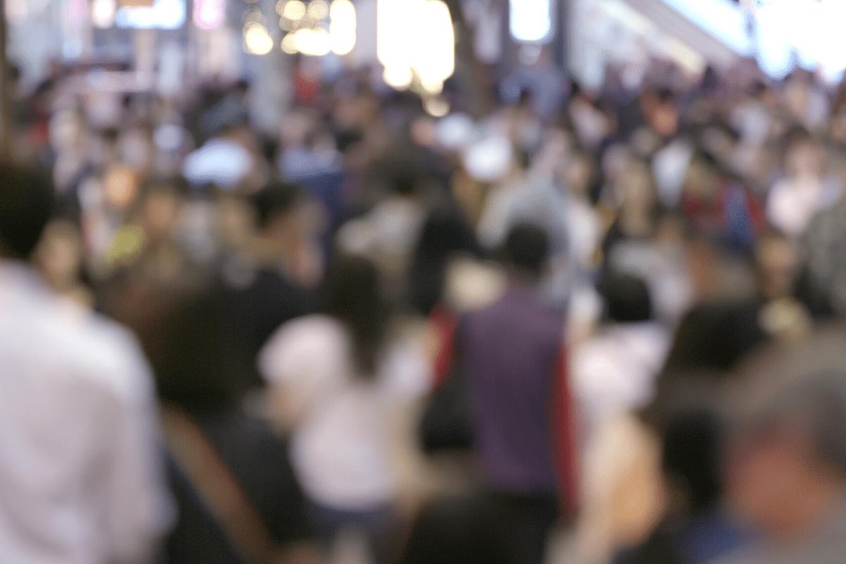 Consumers walking down street
