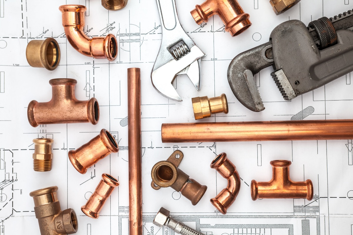Plumbing wrench, pipes, and fittings