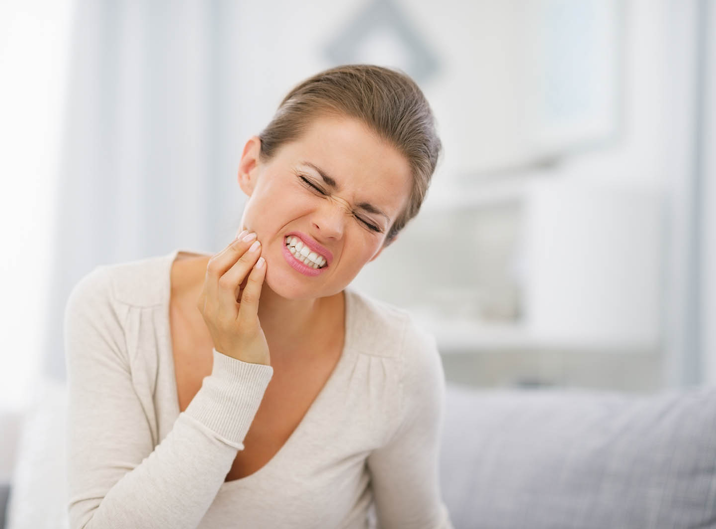 lady touching her hurt jaw