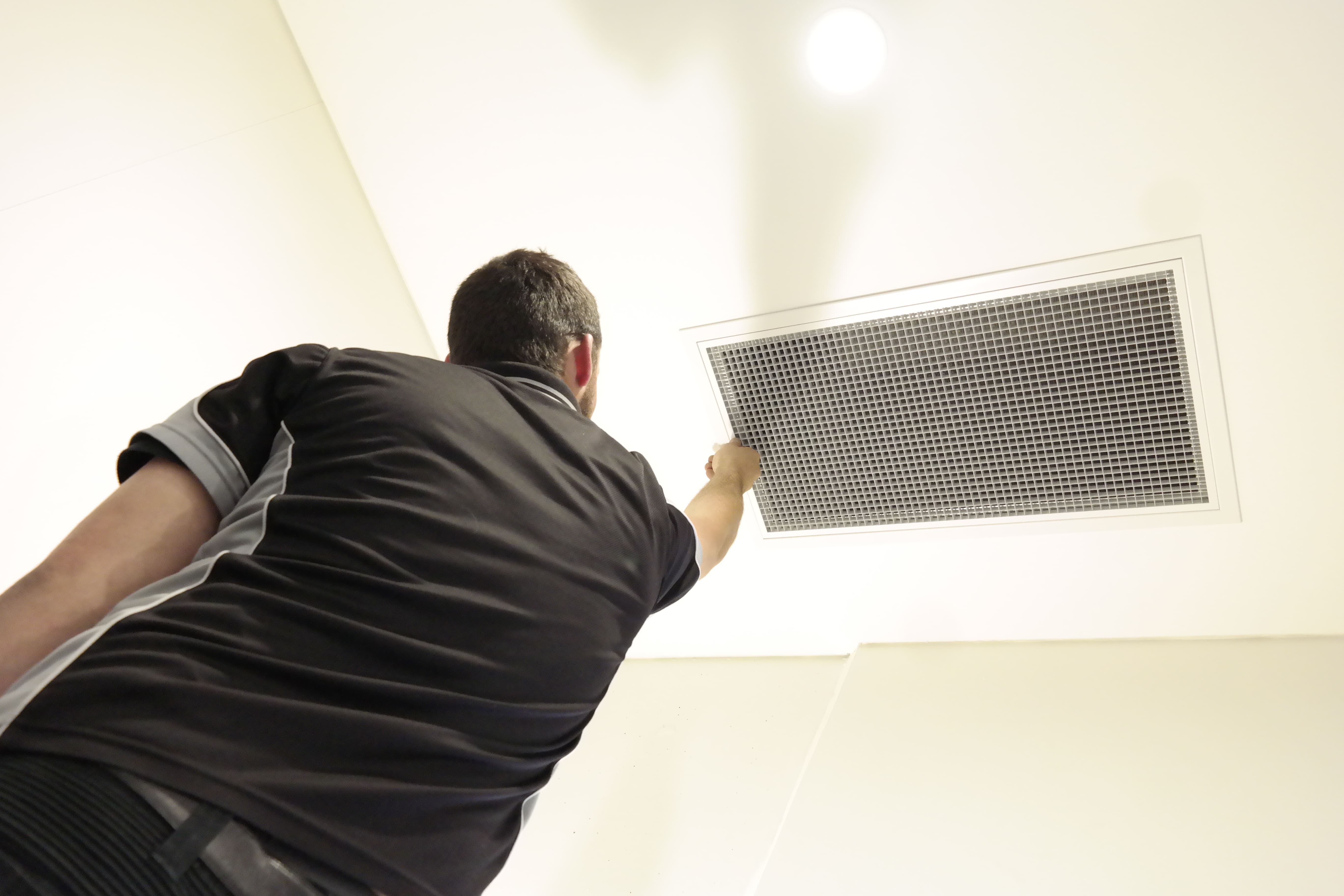 Campbelltown Air Conditioning Employee Cleaning A Filter
