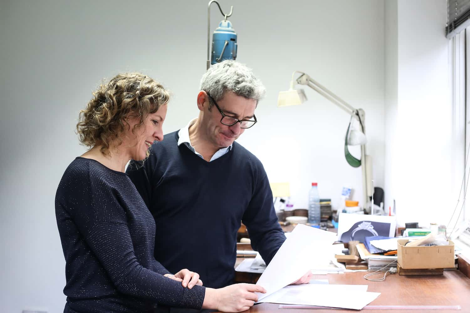 Ruth and a client reviewing some plans