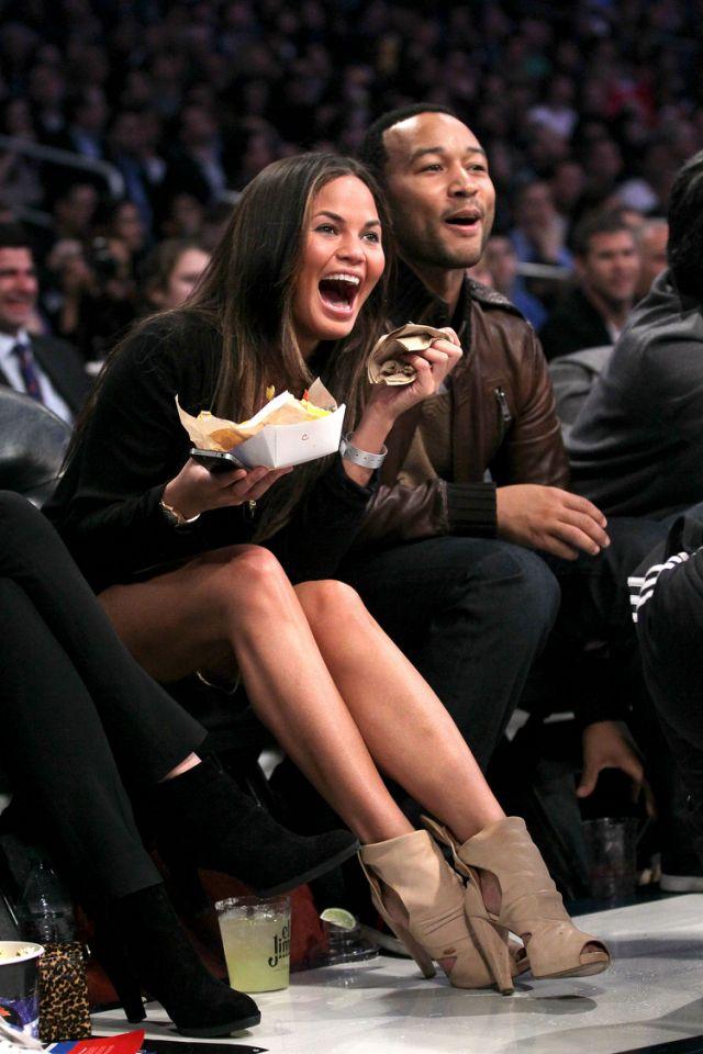 <p>Chrissy Teigen and John Legend attend the 2011 NBA All-Star game. </p>