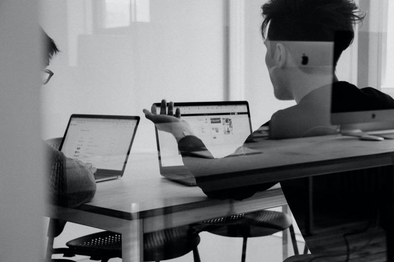 People in a digital marketing meeting in an office