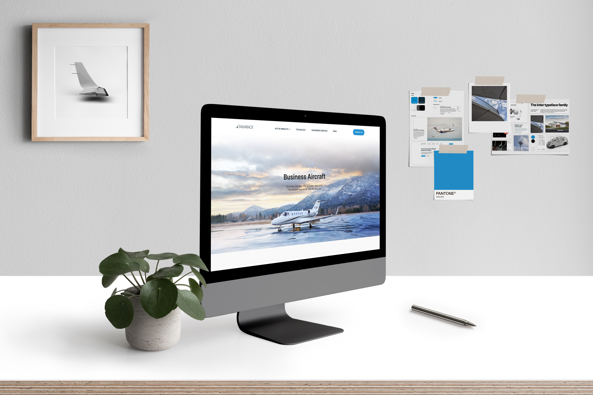 desktop computer with Tamarack Aerospace's new website up, built by Good & Gold Marketing