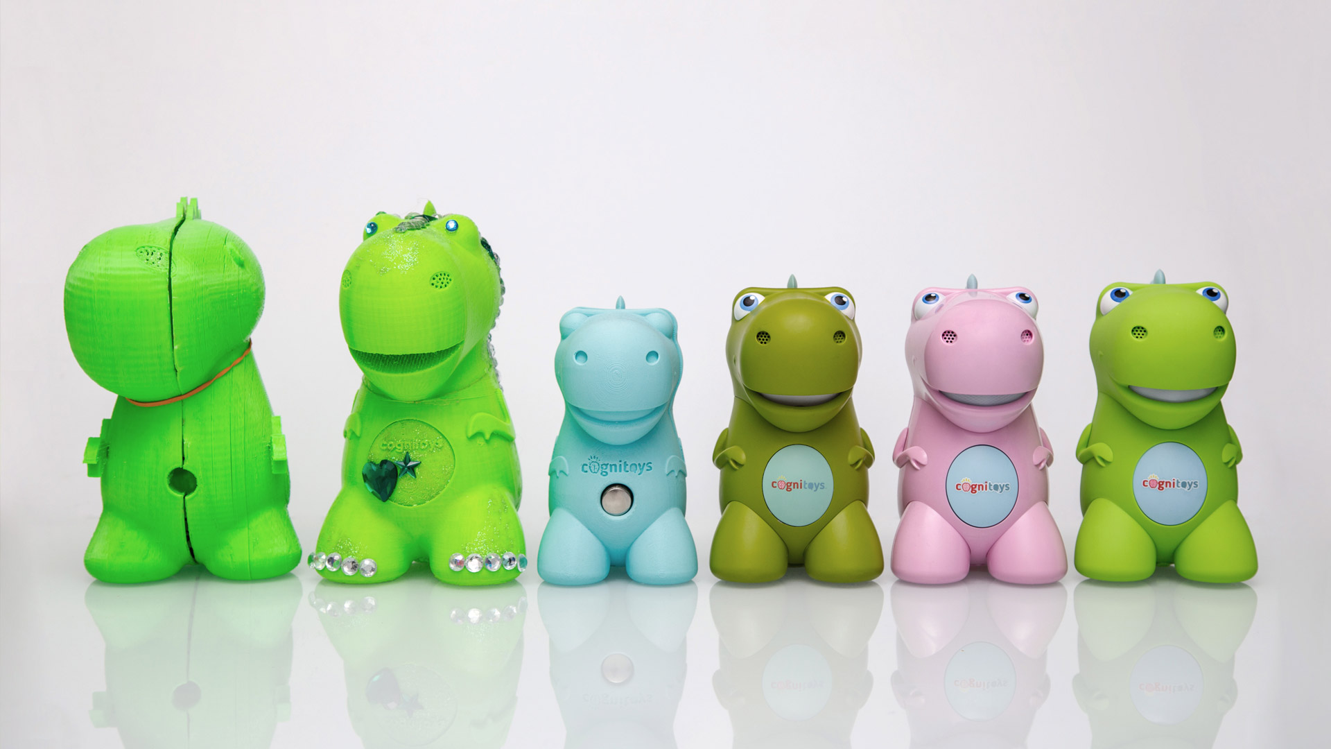 The multiple iterations and evolution of the CogniToys dinosaur product design.