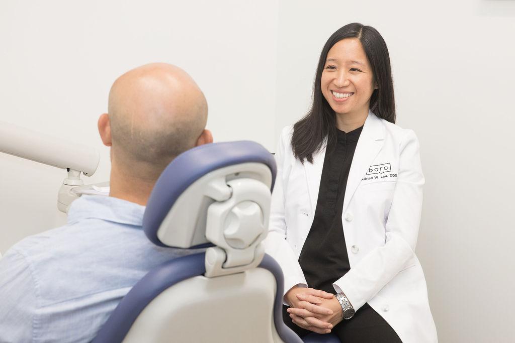 woman getting teeth examined
