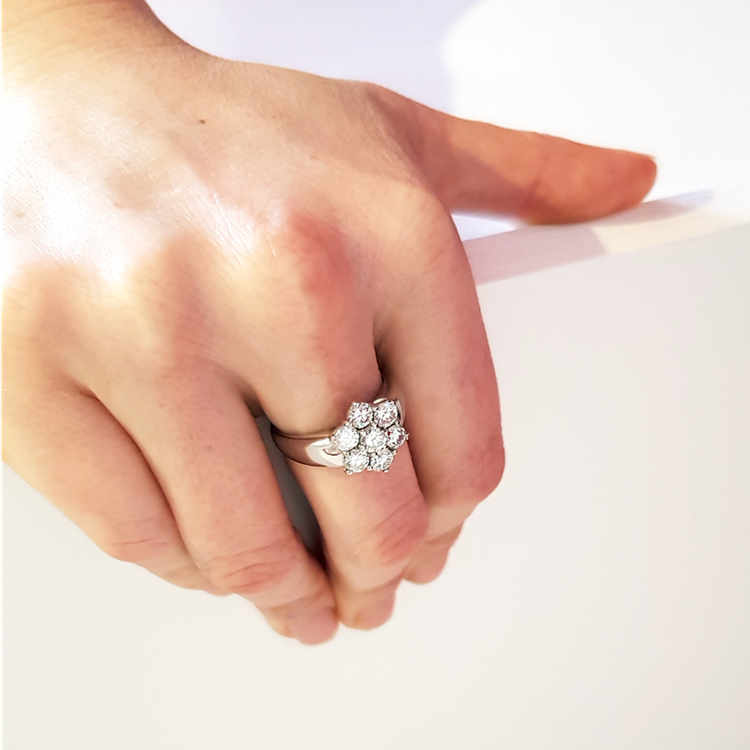 bigger diamond effect with a cluster engagement ring