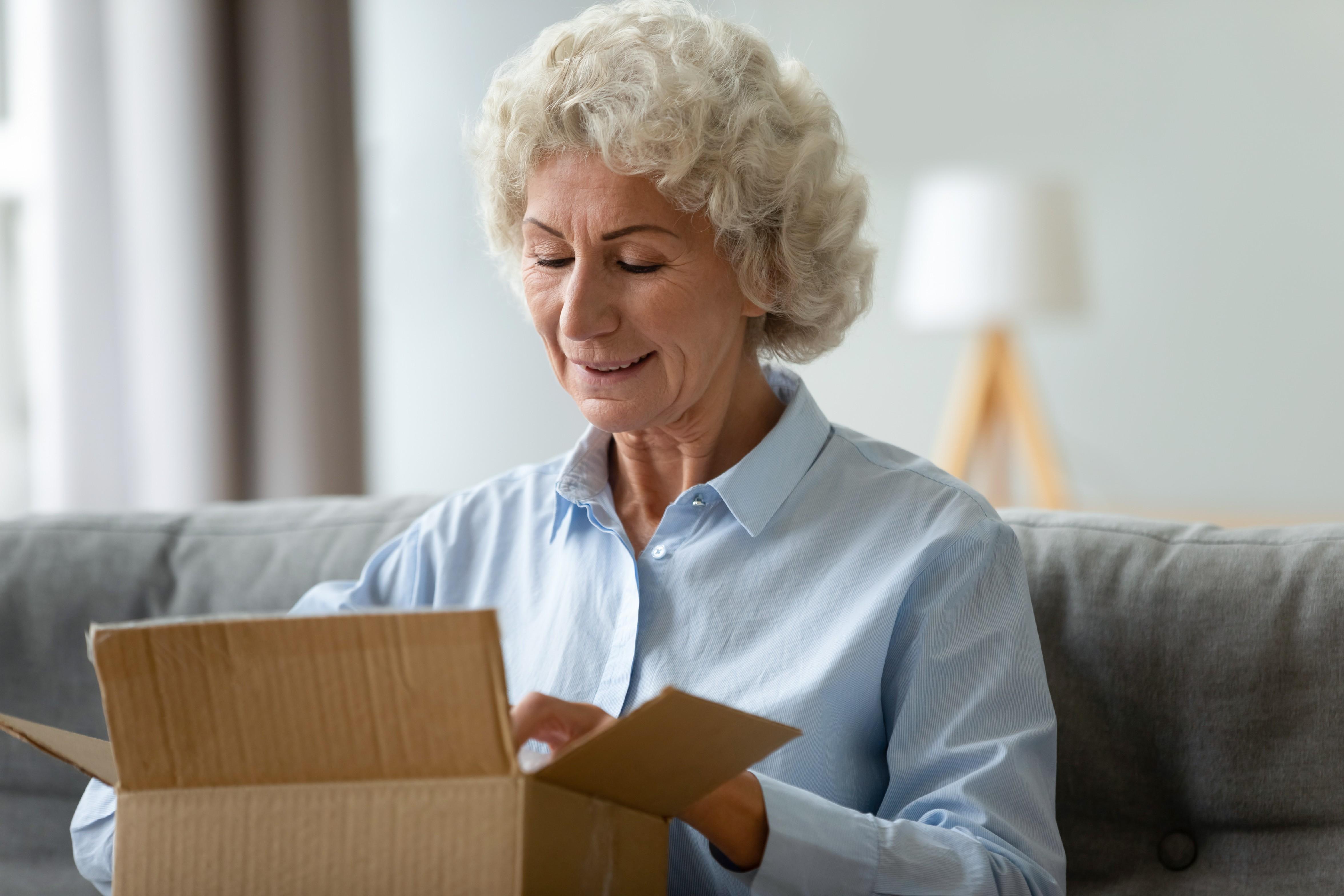 lady-opening-medication-box